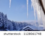 snowy landscape and icicle | Shutterstock . vector #1128061748