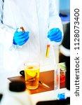 quality control expert... | Shutterstock . vector #1128073400