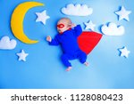 little baby superhero with red... | Shutterstock . vector #1128080423