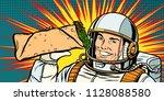 smiling man astronaut presents... | Shutterstock .eps vector #1128088580