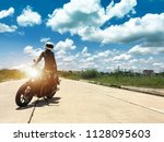 biker girl stand up on modern... | Shutterstock . vector #1128095603
