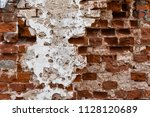 old weathered red bricks wall... | Shutterstock . vector #1128120689