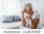 attack of the monster migraine. ... | Shutterstock . vector #1128144530