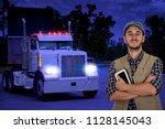 young multitasking man truck... | Shutterstock . vector #1128145043