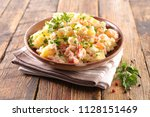 potato salad with salmon and... | Shutterstock . vector #1128151469