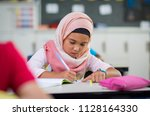little muslim girl wearing... | Shutterstock . vector #1128164330