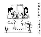 women in the table drinking... | Shutterstock .eps vector #1128179423