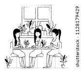 women in the table drinking... | Shutterstock .eps vector #1128179429