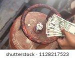 in indian gas price reach... | Shutterstock . vector #1128217523