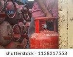 worker delivering lpg gas... | Shutterstock . vector #1128217553