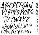 hand drawn dry brush lettering. ... | Shutterstock .eps vector #1128224849