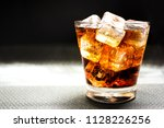 beverage from cola in glass... | Shutterstock . vector #1128226256
