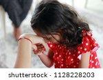 little kid kissing hand. little ... | Shutterstock . vector #1128228203