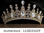 gold crown with diamonds on a... | Shutterstock . vector #1128231029