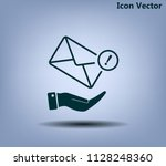 mail envelope on the hand  mail....   Shutterstock .eps vector #1128248360