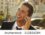 happy young businessman calling ... | Shutterstock . vector #112826284