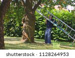 man with aluminum ladder during ... | Shutterstock . vector #1128264953
