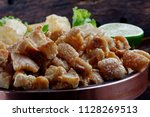 crackling or fried manioc and... | Shutterstock . vector #1128269513