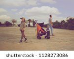 father and two small sons are... | Shutterstock . vector #1128273086
