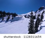 people skiing on white snow ...   Shutterstock . vector #1128311654