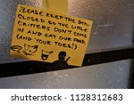 Small sheet of paper warning to keep the door closed to protect the little critters don