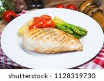 a dish of chicken breast | Shutterstock . vector #1128319730