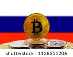 bitcoin btc on stack of... | Shutterstock . vector #1128351206