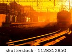 sunrise at railway depot train... | Shutterstock . vector #1128352850