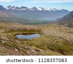 beautiful nordic landscape with ... | Shutterstock . vector #1128357083