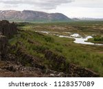 nordic landscape with mountains ... | Shutterstock . vector #1128357089