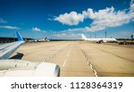 airplane at the airport takeoff ... | Shutterstock . vector #1128364319
