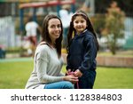 mom and daughter portrait | Shutterstock . vector #1128384803