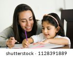young mother and daughter doing ... | Shutterstock . vector #1128391889