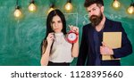 man with beard hold book and... | Shutterstock . vector #1128395660