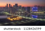 abu dhabi city skyline with... | Shutterstock . vector #1128426599