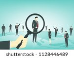 a hand holding magnifying glass ...   Shutterstock .eps vector #1128446489