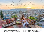 breakfast on the roof with... | Shutterstock . vector #1128458330