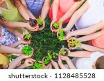 people hands cupping plant... | Shutterstock . vector #1128485528