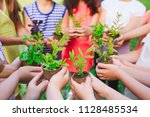 people hands cupping plant... | Shutterstock . vector #1128485534