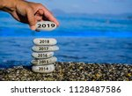 new year 2019 is coming concept.... | Shutterstock . vector #1128487586