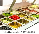 Stock photo tray with cooked food on showcase at cafeteria 112849489