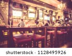 defocused blur from irish pub... | Shutterstock . vector #1128495926