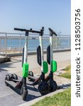 Small photo of MARINA DEL REY, CA - JULY 6, 2018: LIME, a BIRD electric scooter competitor has shown up on the sidewalks in Los Angeles County.