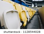 numbered rows of yellow and... | Shutterstock . vector #1128544028