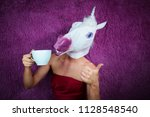 funny girl unicorn drinks tea... | Shutterstock . vector #1128548540