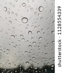 rain drops on the windshield. | Shutterstock . vector #1128554339
