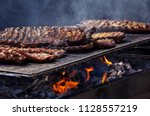 beef ribs cooking on barbecue... | Shutterstock . vector #1128557219