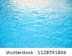 blue water in swimming pool for ... | Shutterstock . vector #1128591806