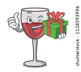 with gift wine mascot cartoon... | Shutterstock .eps vector #1128593996