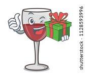 with gift wine mascot cartoon... | Shutterstock .eps vector #1128593996